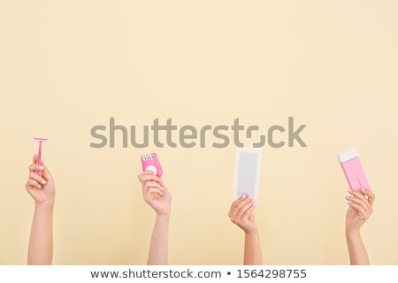 Woman Holding Wax Strip And Razor Stock photo © AndreyPopov