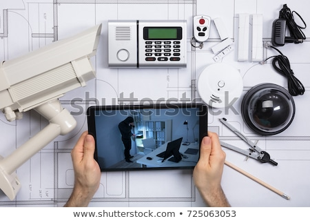 Architecture Looking At CCTV Footage On Digital Tablet Stock photo © AndreyPopov