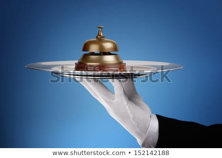 Waiter Hand Holding Service Bell In Tray Stock photo © AndreyPopov