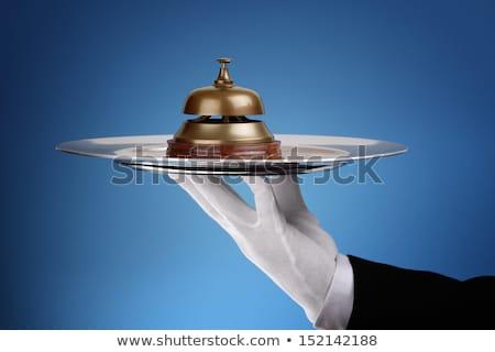 kéz · tart · szolgáltatás · harang · közelkép · fehér - stock fotó © andreypopov