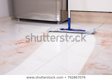 Janitor Cleaning Kitchen Floor With Vacuum Floor Stock photo © AndreyPopov