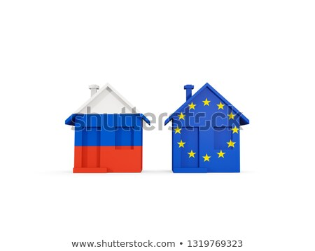 Two houses with flags of Russia and EU Stock photo © MikhailMishchenko