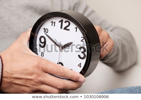 Man Adjusting The Hour Clock Stock photo © AndreyPopov