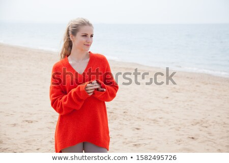 Alluring, young lady relaxing on a tropical beach Stock photo © konradbak