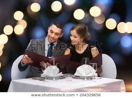 Couple Dining Restaurant, People Sitting by Table Stock photo © robuart