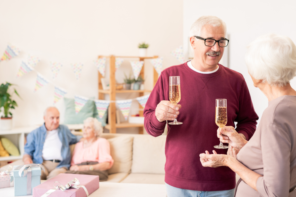 Senior spouses toasting with flutes of champagne Stock photo © pressmaster