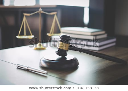Gavel on wooden table and Lawyer or Judge working with agreement Stock photo © Freedomz