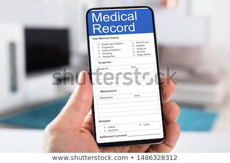 человека заполнение пациент информации форме смартфон Сток-фото © AndreyPopov