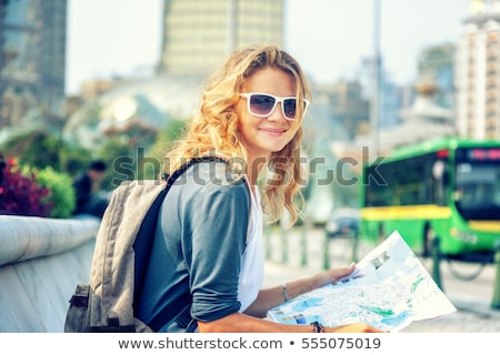 Stock photo: happy women with map on street in summer city