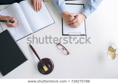 close up of gavel male lawyer or judge consult with client and stock photo © freedomz