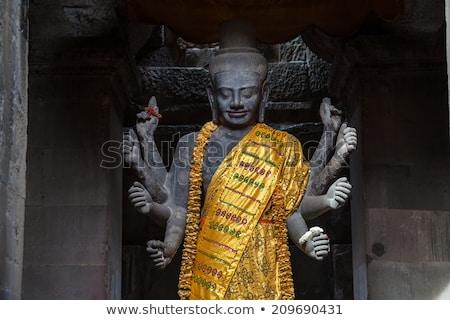 Сток-фото: статуя · Ангкор-Ват · Постоянный · восемь · оружия · зонтик