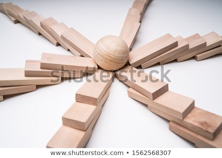 Silver Ball In The Center Of Collapsed Wooden Dominoes Stock photo © AndreyPopov