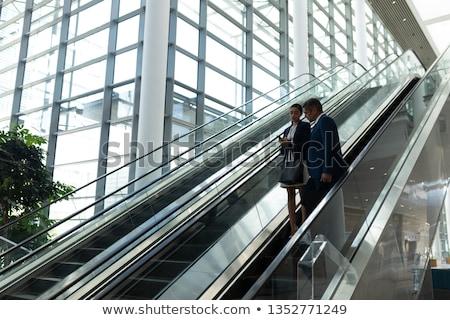 Oldalnézet üzletember üzletasszony egyéb mozog lefelé Stock fotó © wavebreak_media