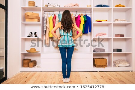 Young Woman Selecting New House Stock photo © AndreyPopov