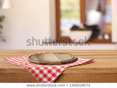 Kitchen table with plate and tablecloth Stock photo © karandaev
