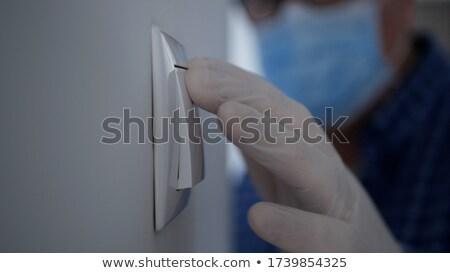 Mann Lichtschalter blau Licht Stock foto © nito