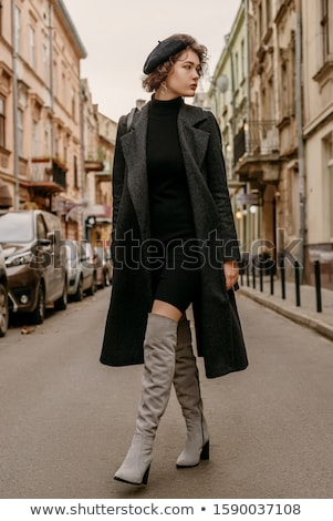 Attractive young brunette woman wearing autumn coat walking Stock photo © deandrobot