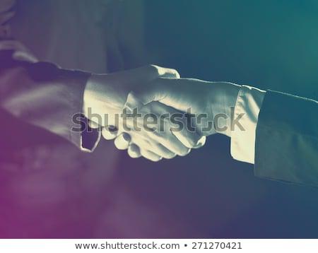 Stretta di mano luce seppia buio business mani Foto d'archivio © adamr