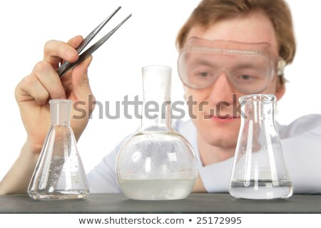 Chemist with tweezers and three flasks Stock photo © Paha_L