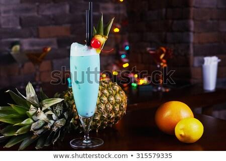 Blue alcohol cocktail with lemon slices and maraschino Stock photo © karandaev