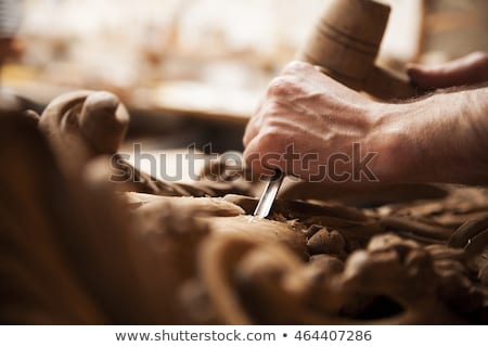 Traditional craftsman carving wood Stock photo © lightkeeper