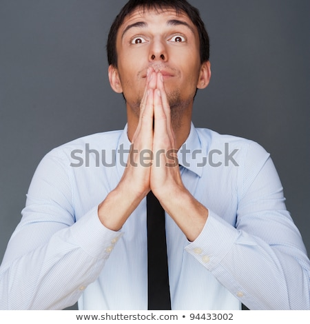 profile shot of professional man holding hands up to face agains stock photo © hasloo