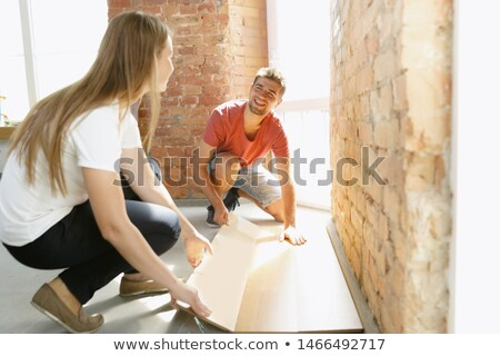 Smiling painter laid on the floor stock