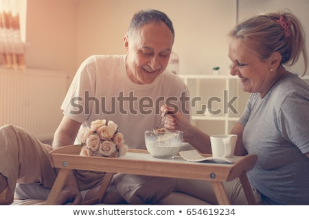 senior couple having breakfast in bed stock photo © photography33