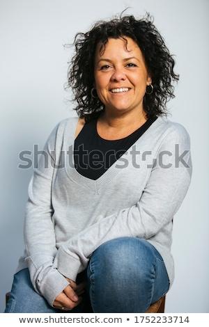Mujer atractiva negro sesión blanco silla zapatos Foto stock © photography33