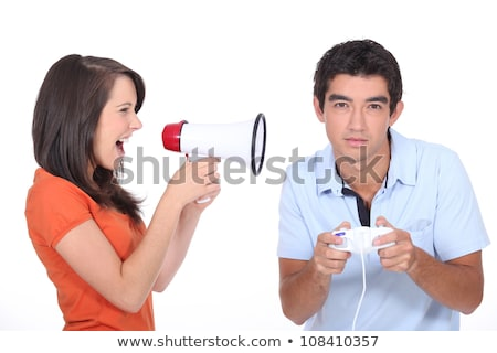 Girl screaming into megapgone whilst boyfridnd plays vide games Stock photo © photography33