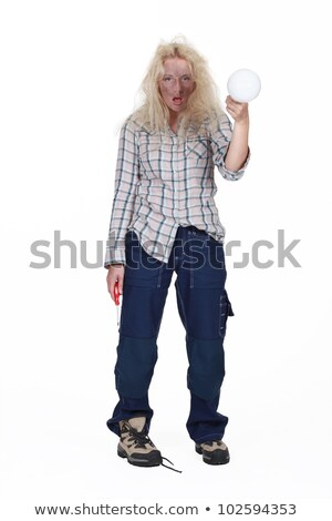 Electrocuted woman holding a lightbulb Stock photo © photography33