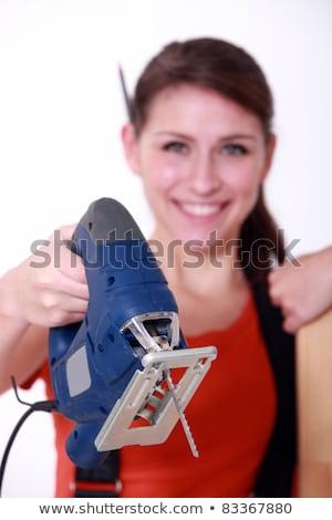 Female artisan holding jigsaw Stock photo © photography33