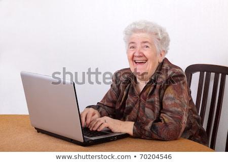 старушку смеясь ноутбука интернет счастливым технологий Сток-фото © photography33