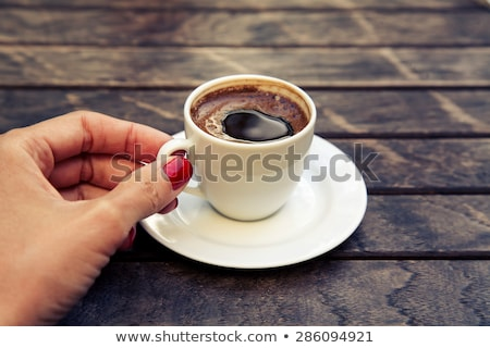 Woman holding espresso Stock photo © photography33