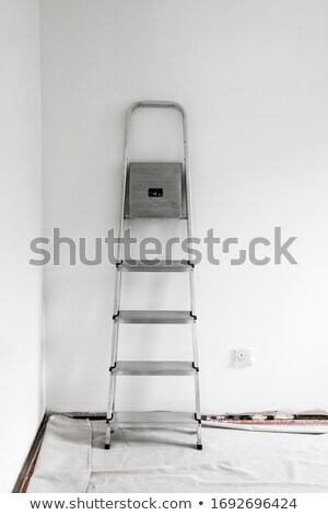 Tradesman leaning against a stepladder Stock photo © photography33