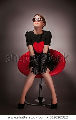 Szexi barna hajú ül fotel nő pózol Stock fotó © kalozzolak
