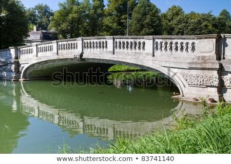 Stone Bridge Crossing The Nymphenburg Canal In Munich Germany Stok fotoğraf © haraldmuc