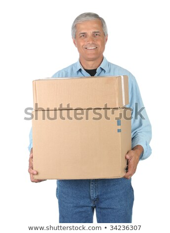 Happy mature courier man carrying cardboard boxes stock photo © wavebreak_media