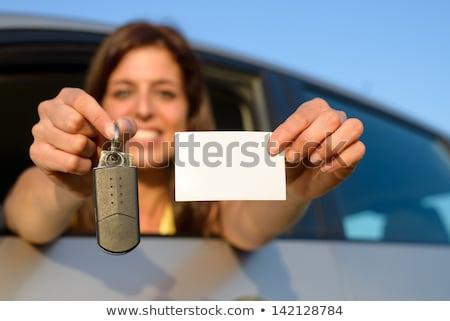Meisje auto tonen sleutel lege witte Stockfoto © Nobilior