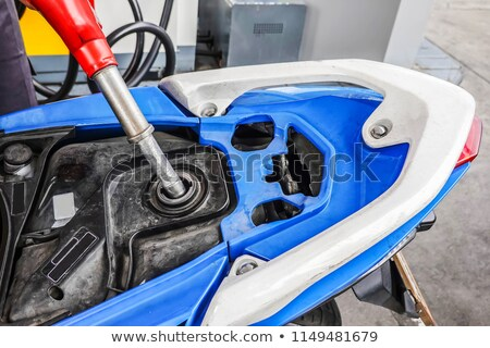 man holding gas nozzle to head stock photo © iofoto