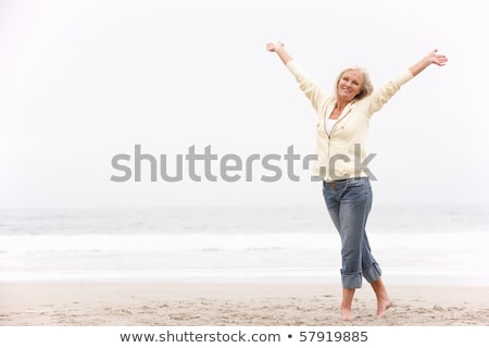 Running woman arms outstretched Stock photo © blasbike