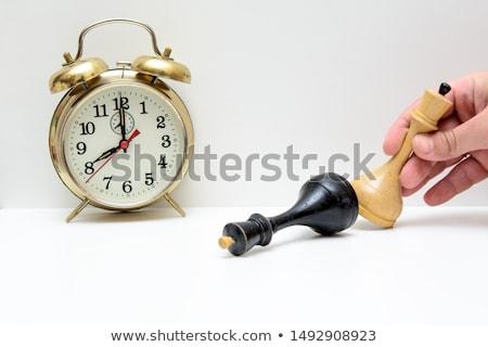 Hand knocking down vintage clock Stock photo © stevanovicigor