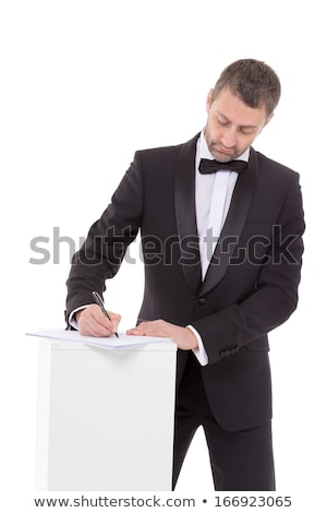 Man in a bow tie completing a form Stock photo © Discovod