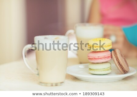 Woman eating french cookies at home Stock photo © nenetus