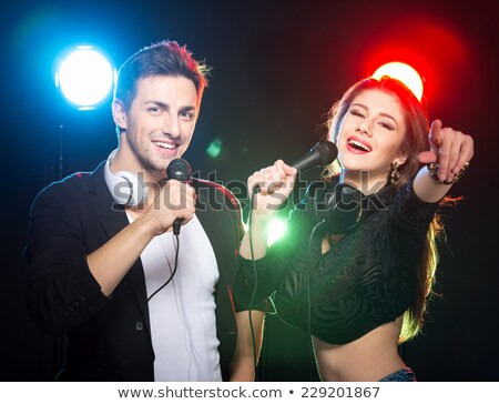 Two DJs at the turntable in club Stock photo © Kzenon