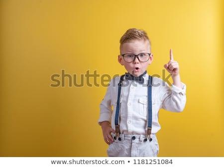 smart boy in studio isolated on white stock photo © meinzahn