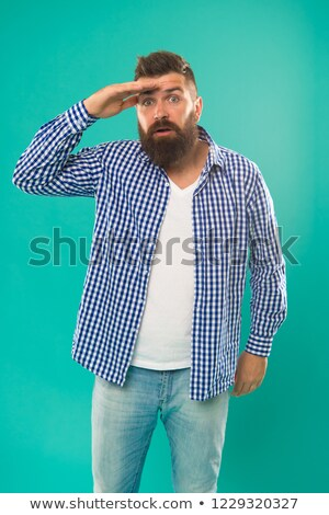 young bearded man looks forward stock photo © feedough