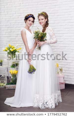 Portrait of Two Romantic Females with Violet Flowers Stock photo © gromovataya