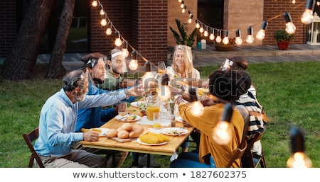 Stock photo: Multi Generation Family Having Outdoor Barbeque