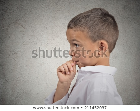 Thinking man with finger in mouth, sucking thumb stock photo © ichiosea